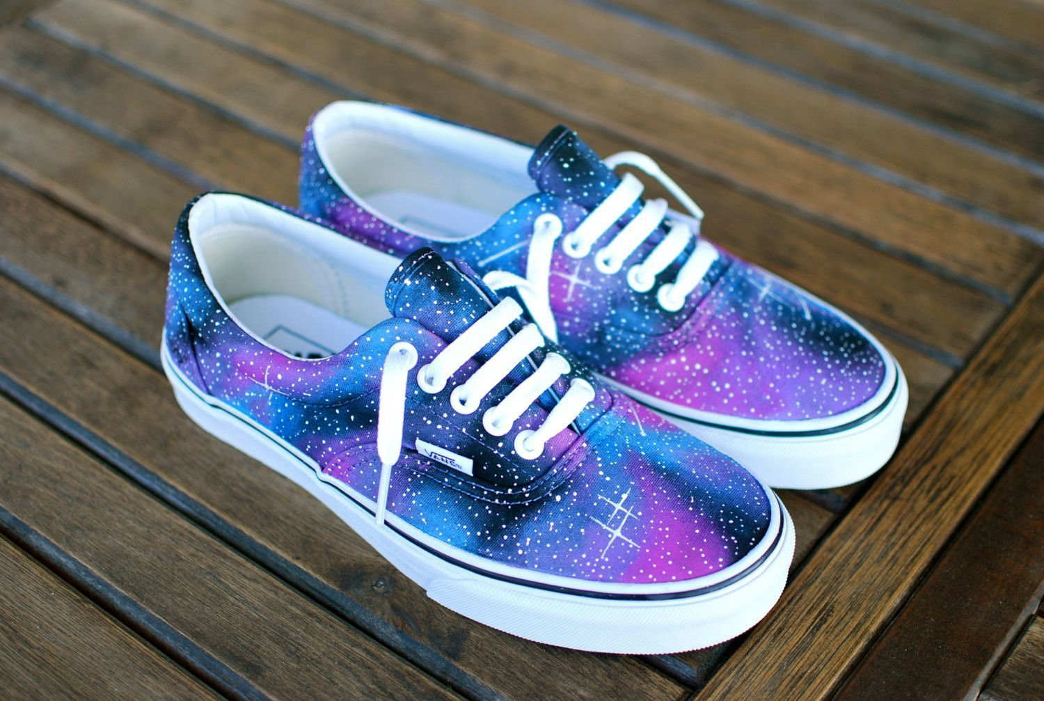 These one of a kind hand painted Vans Era shoes feature a