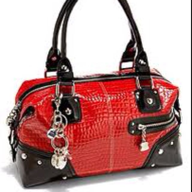 aaafe0b58386 I LOVE my red Kathy Van Zeeland bag!