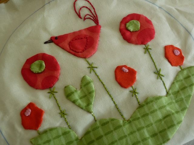 Flowers and birds applique tea cozy. Link not quite true - will have to find the pattern.