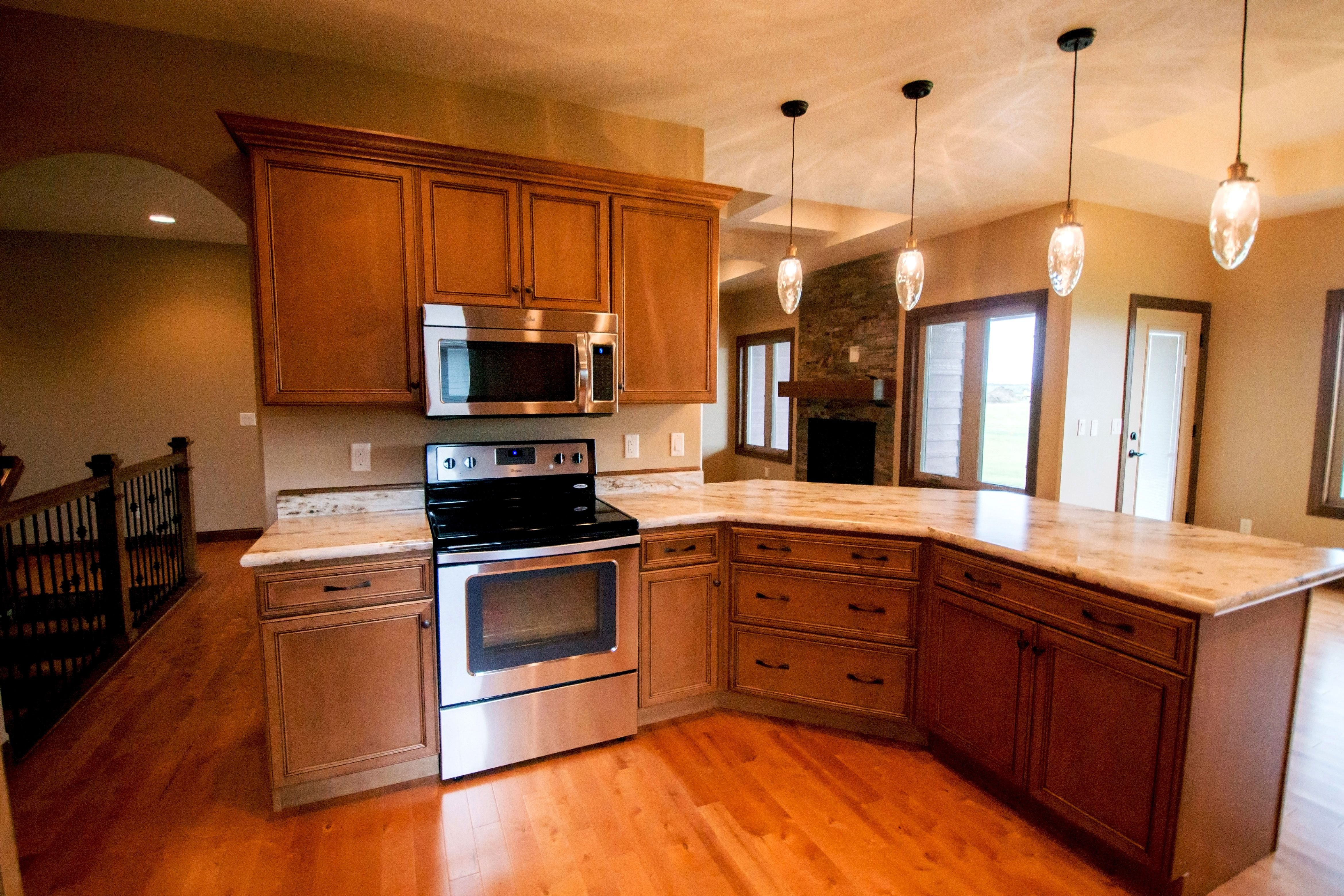 Kitchen Features Open Layout And Connects To Mudroom Starmark Cabinetry Cabinets In Maple Finished In Retro Appliances Home Appliances Local Furniture Stores