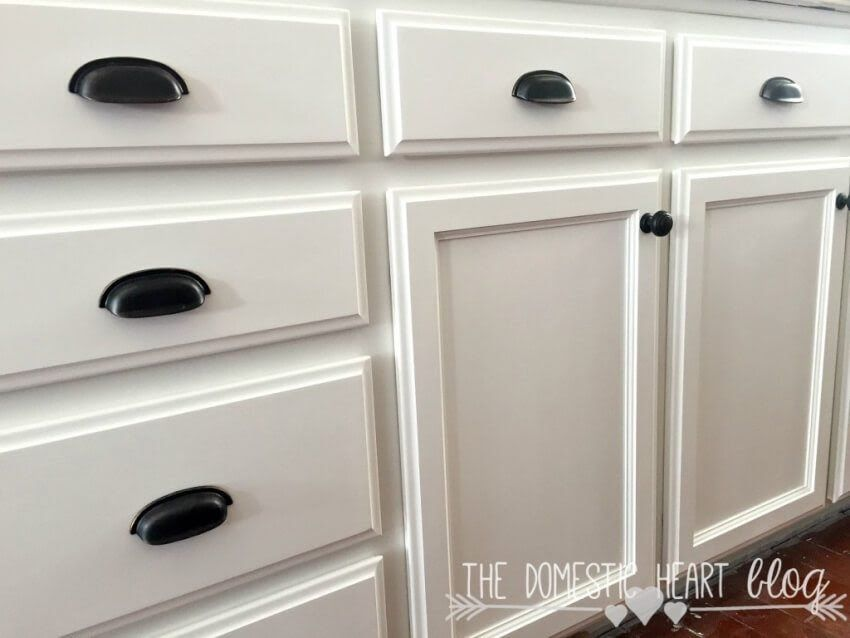 White Kitchen Cabinets Close Up With Black Drawer Half Moon Pulls