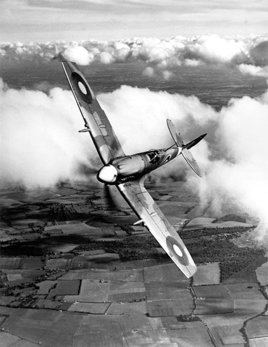 Spitfire fighter banking in the clouds, date unknown