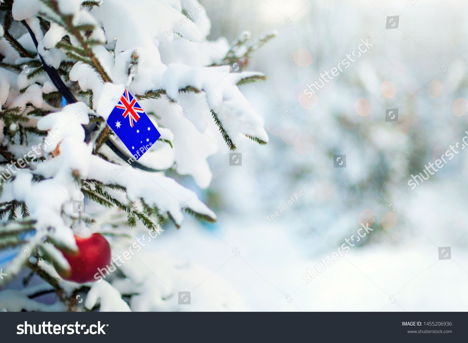 Christmas Tree Covered With Snow And A Flag Of Australia