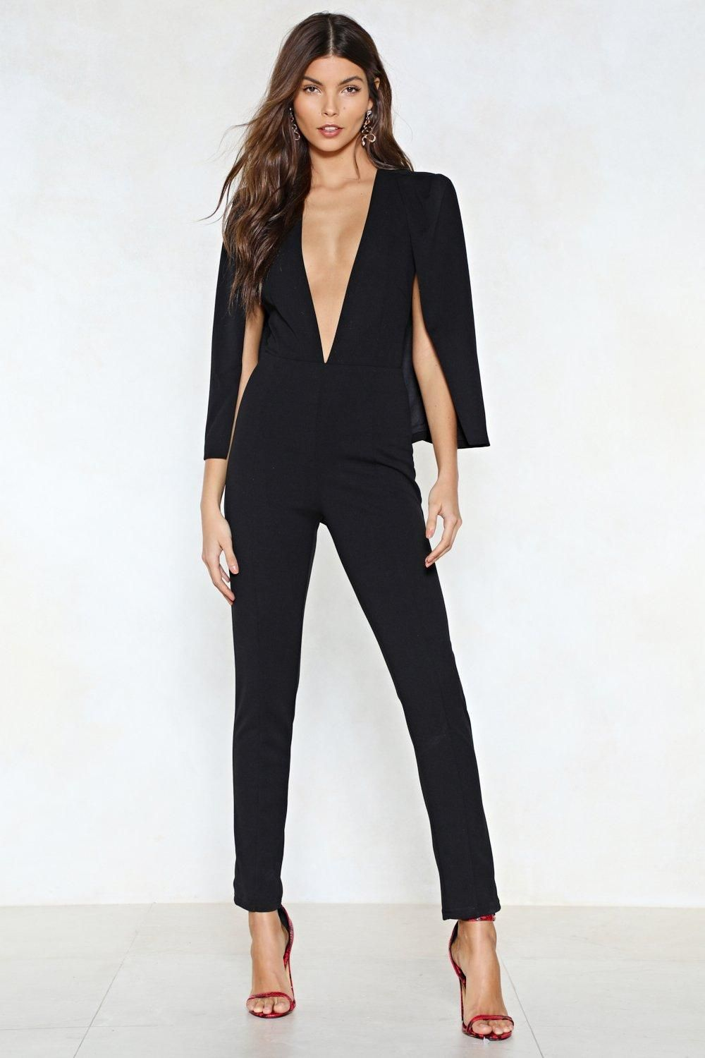 100f0f770e56 The Cape it Together Jumpsuit features a plunging neckline