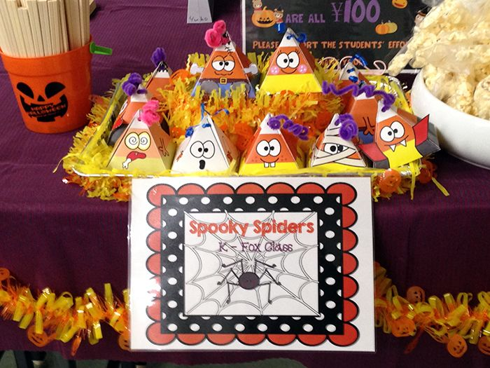 a teacher used these fun gift boxes to sell baked goods at her schools halloween bazaar