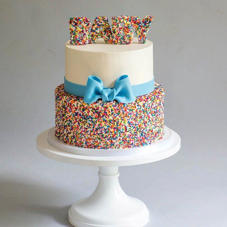 Buttercream And Rainbow Sprinkles With Blue Bow Baby Shower Cake