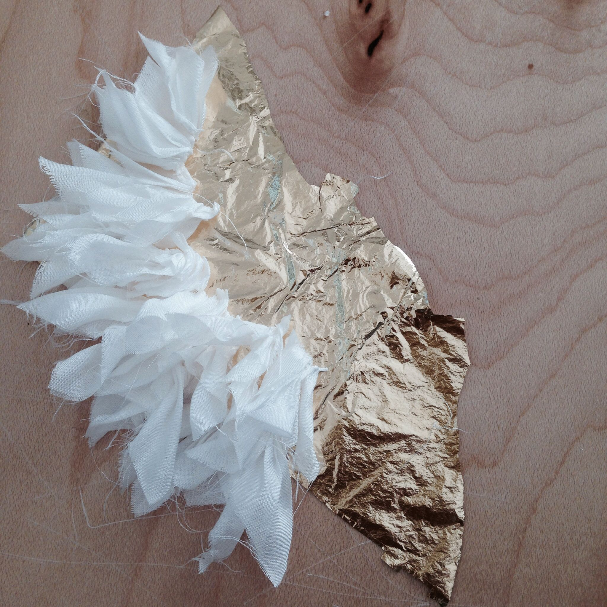 Gold leaf, bound and set silk pieces. Hair pin, bridal piece in the making.