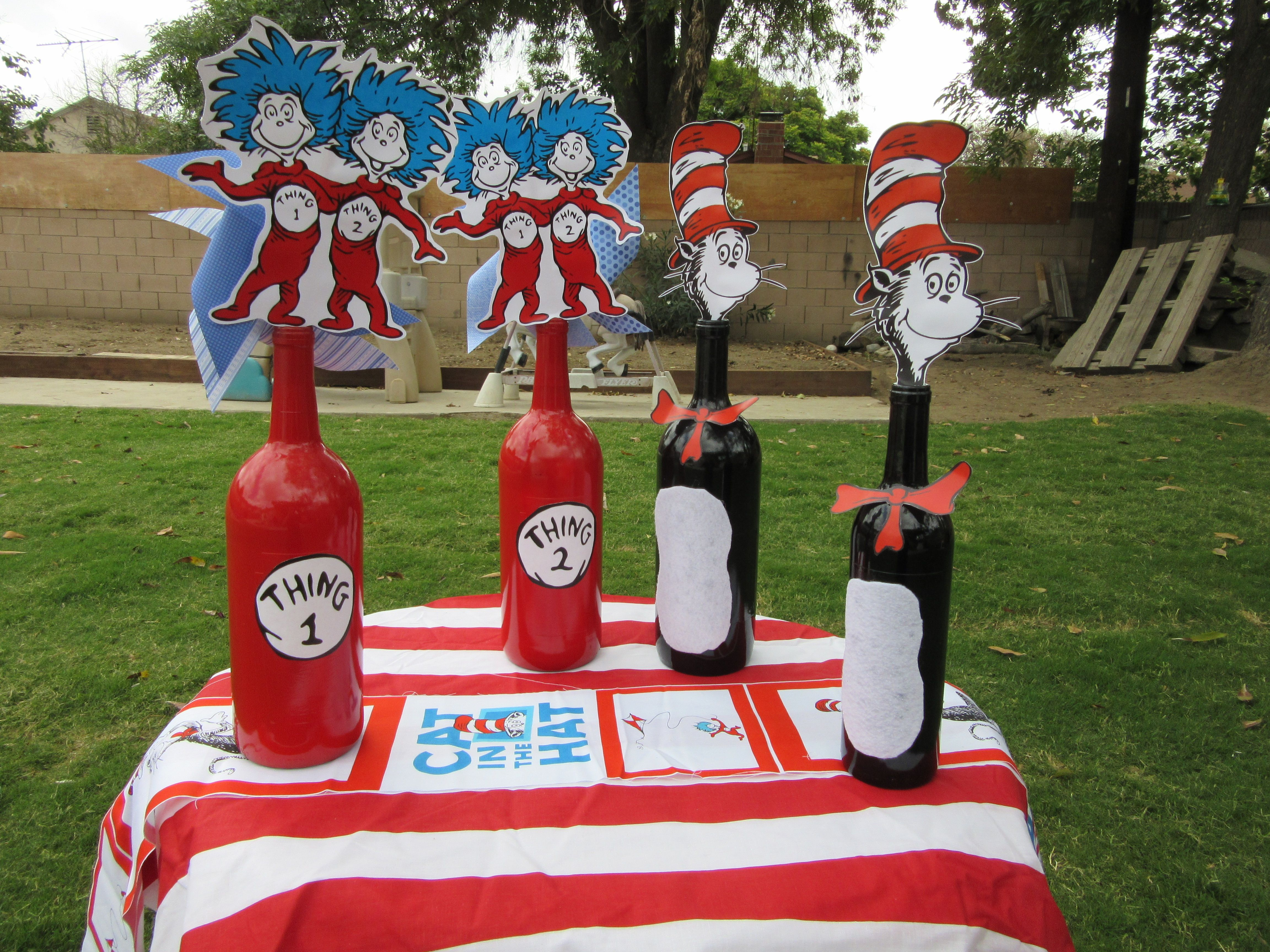 Spray painted wine bottles Thing 1 & Thing 2 Dr Seuss