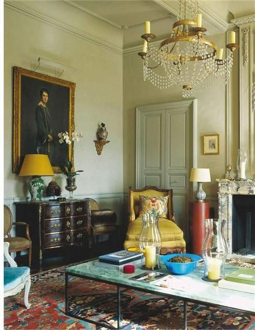 Rug and yellow accents (chaise and lampshade)