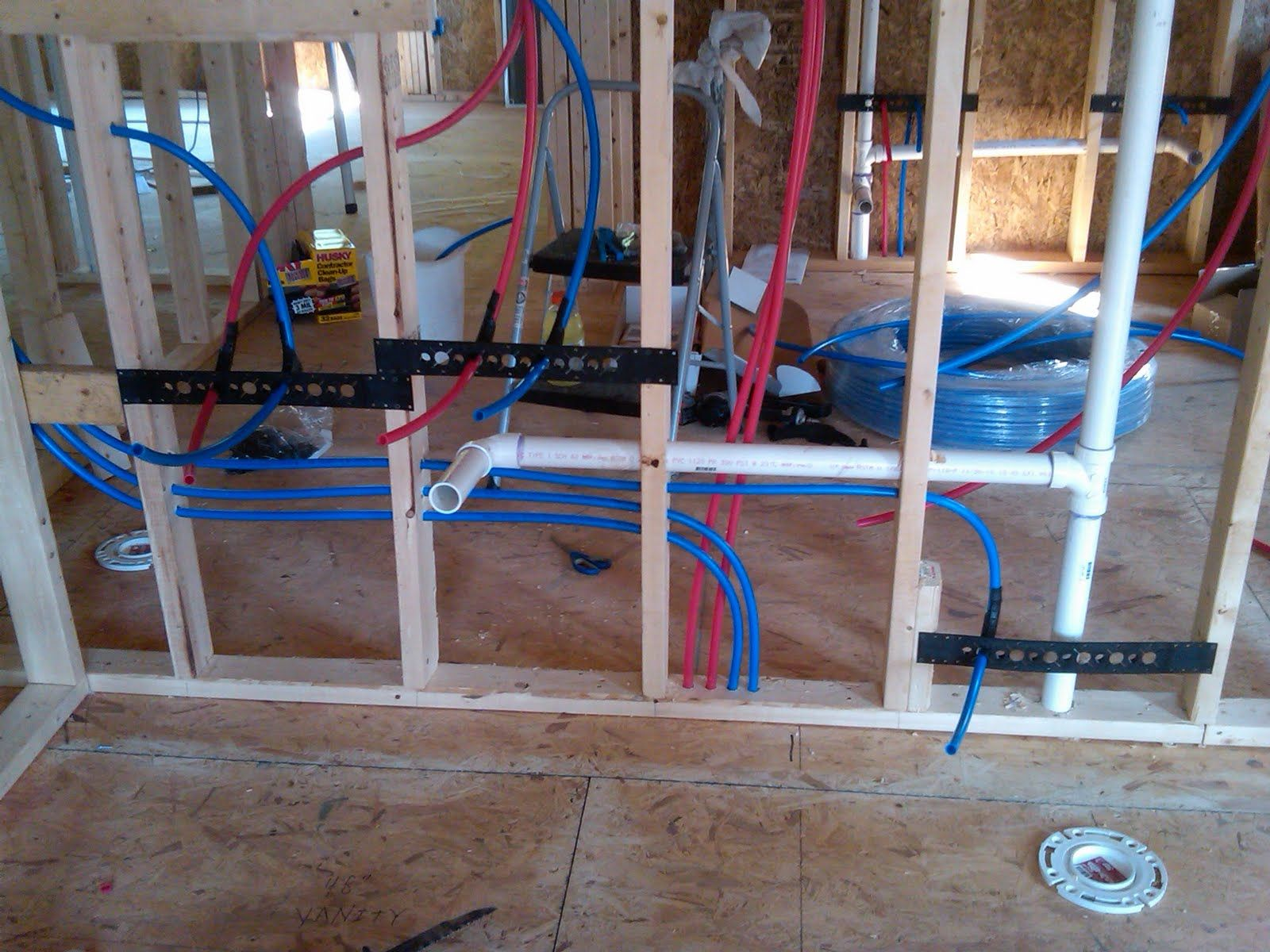 Plumbing pex water lines install for toilet sinks for New home plumbing