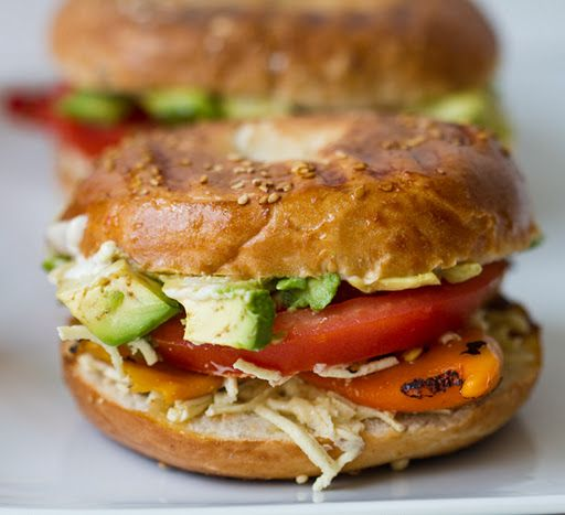roasted yellow pepper, tomato, and avocado bagel sandwiches