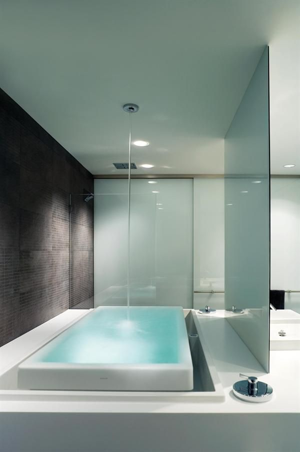 The Infinity Tub Is Filled From The Ceiling And Overflows Into The