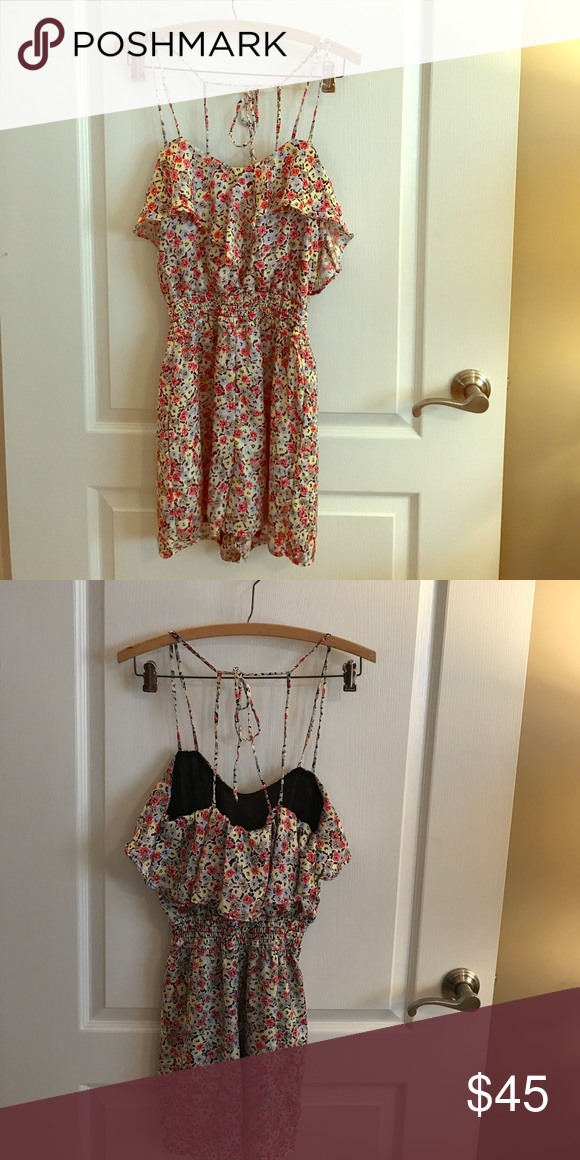 BCBGeneration Floral Romper BCBGeneration Floral Romper Size XS but can fit as a Small. Adjustable strings to adjust length or how tight you want it. Wore once. In excellent condition. Great for the spring and summer.                                                           ✔️REASONABLE OFFERS WELCOMED.                               👗🛍 BUNDLE & SAVE BCBGeneration Pants Jumpsuits & Rompers