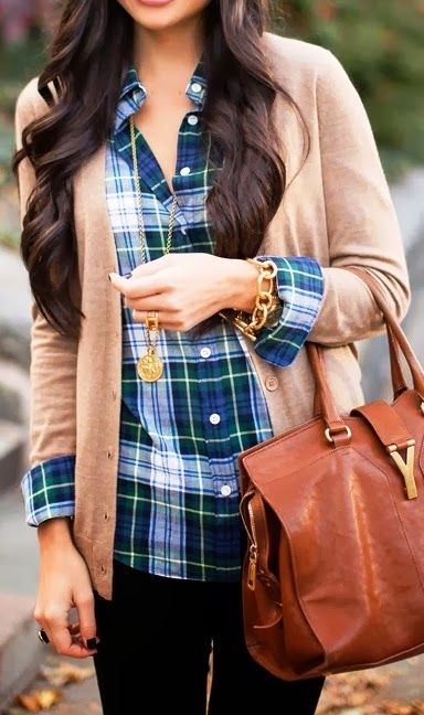 Elevate a simple look by folding the cuffs of your button-down over a cardigan. Plaid shirt, neutral cardigan sweater, dark jeans