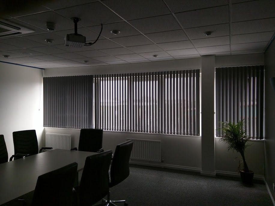 Vertical blinds for a meeting room installed by The Blind Shop http