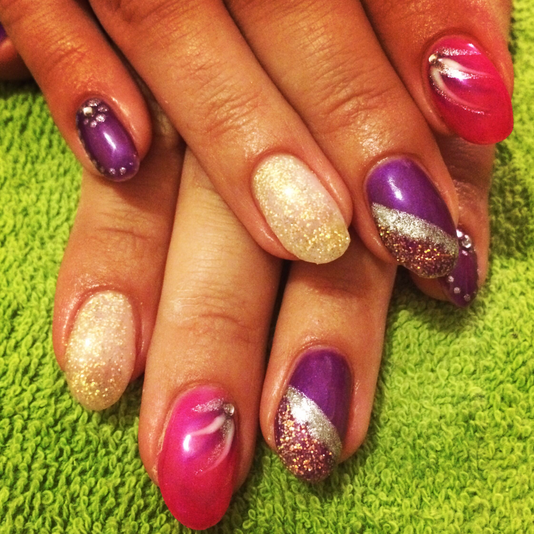 Pink purple and glitter gel polish gel nails with nail art and diamantés