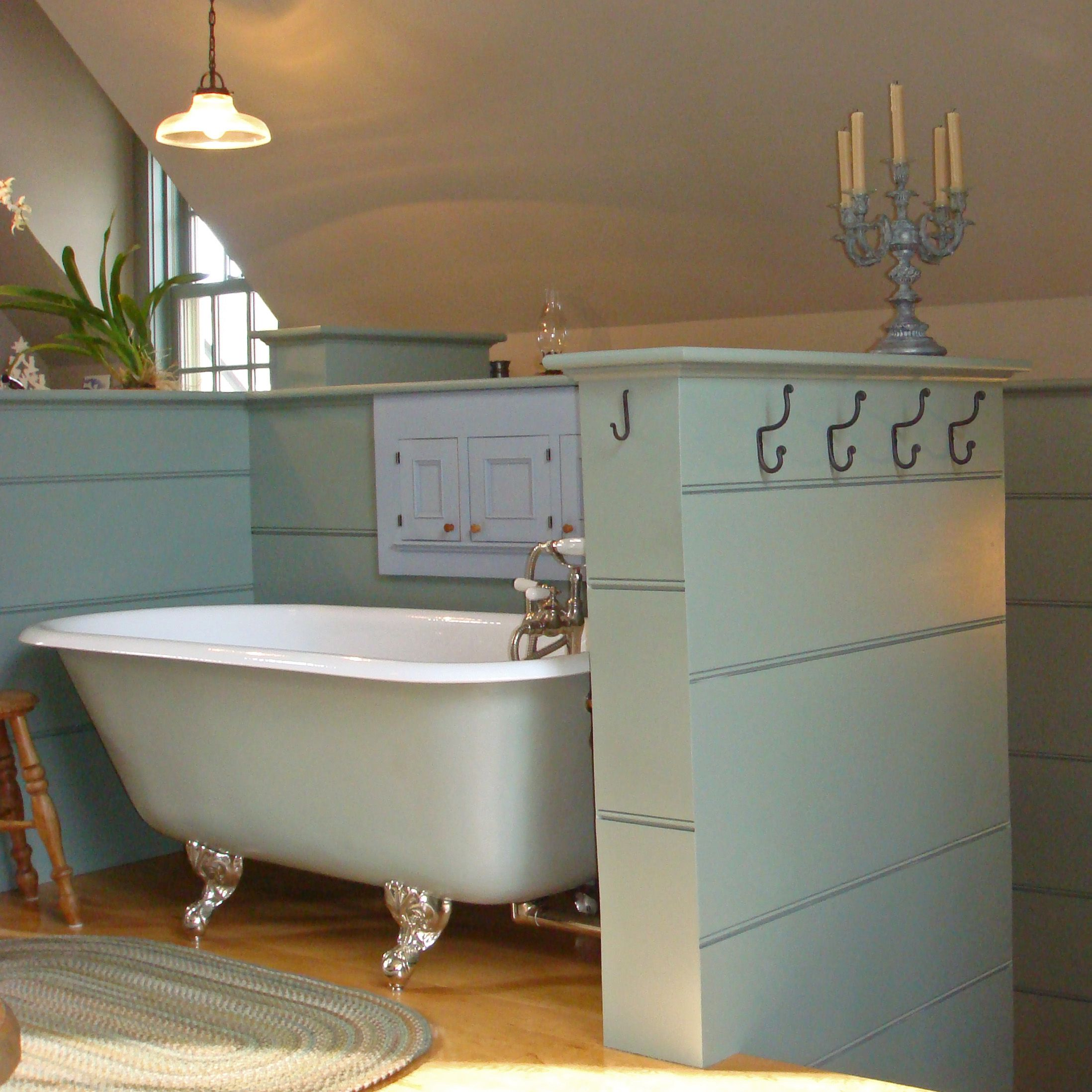 This Claw Foot Tub Sits At The Top Of The Stairs Of A