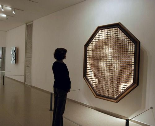 wooden mirror, it senses motion in front of it and angles the wooden blocks to create the imaged sensed in front of it.