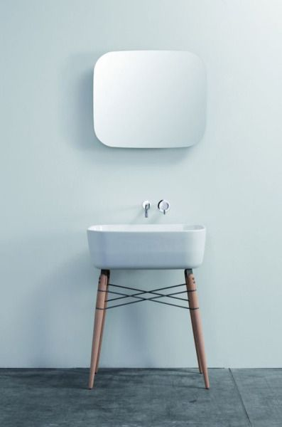 urbnite:  Sink design inspired by the Eames Molded Side Chair with Dowel Legs