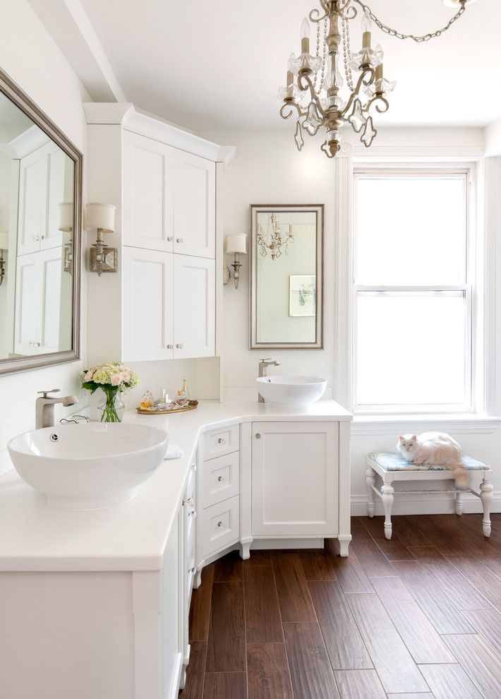White Bathroom With White Wall And Ceiling White Vanity Chandelier Wooden Flooring Mirr Transitional Bathroom Design Corner Bathroom Vanity Bathroom Design