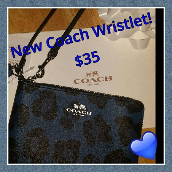 "NEW Coach Wristlet! This is a NEW Coach wristlet that is sure to be a perfect accent to your wardrobe!  The ocelot print with the pop of blue, makes this wristlet a standout piece! It is coated canvas, with a leather strap and a top zip closure. It measures (6"" x 4"") and has two inside pockets for credit cards and ID's.                 ***Gift box included with purchase *** Coach Bags Clutches & Wristlets"