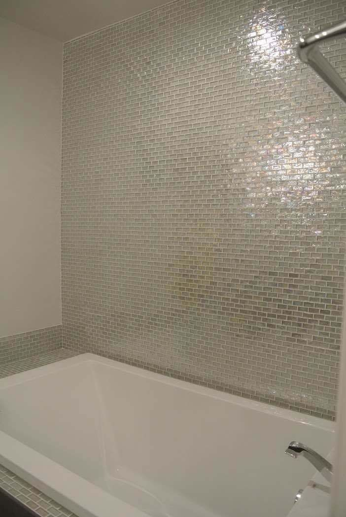 Contemporary bath tub and shower wall made of iridescent glass tiles white by mineral decora  pinterest baths tubs also