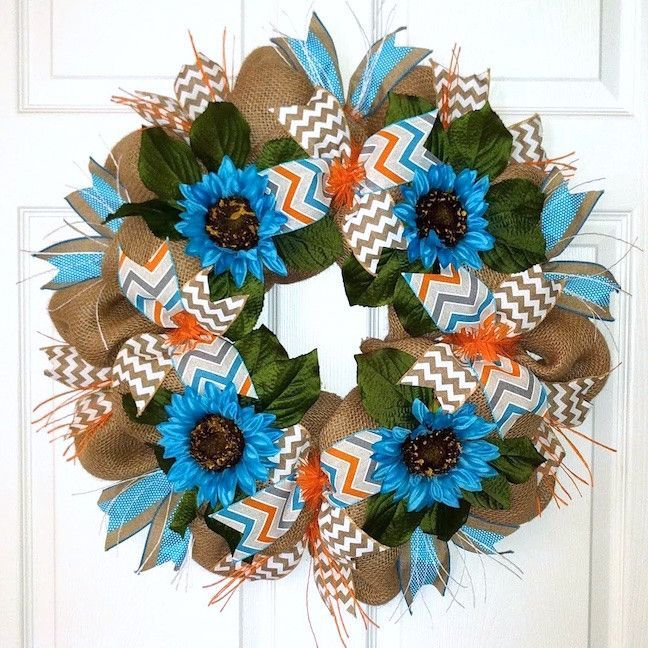 The Summer Sunset Wreath is reminiscent of a summery sunset. Rustic burlap are ...  The Summer Sunset Wreath is reminiscent of a summery sunset. Rustic burlap are ...