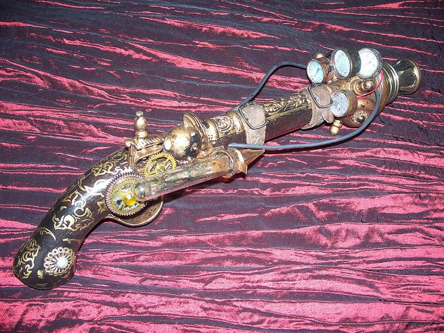"""""""THE BLUEBLOOD"""". Originally handsmithed in the Royal armouries, an inexhaustible ambergoen crystal for power, brass gears for clockwerk precision every firing, double buckled barrel for support, and triple fin radiator and four pressure gauges means no guesswork. """"The Prince of Nowhere"""" had an exactness for executing the construction of this gun and in executing his enemies. So, call him a pirate or a hero or maybe a lost soul ..."""