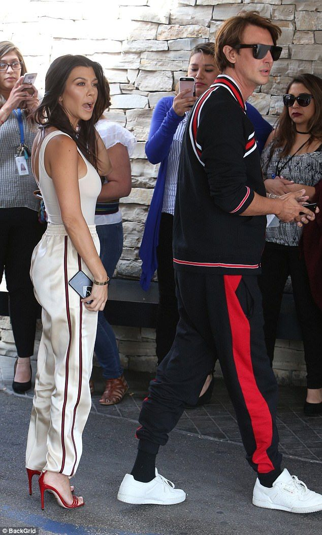 702a0835132e1 Silky  Kourt wore baggy silk pants with heels while Jonathan sported a red  and black sweat... Braless Kourtney Kardashian ...