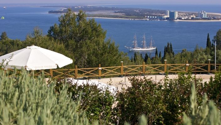 Located on the slope of Serra da Arrábida, the view from Hotel Quinta dos Moinhos de S. Filipe is dazzling, with the mouth of River Sado, its meeting with the Atlantic Ocean and all the life which thrives in both as its natural background. Windmill, Setubal Portugal