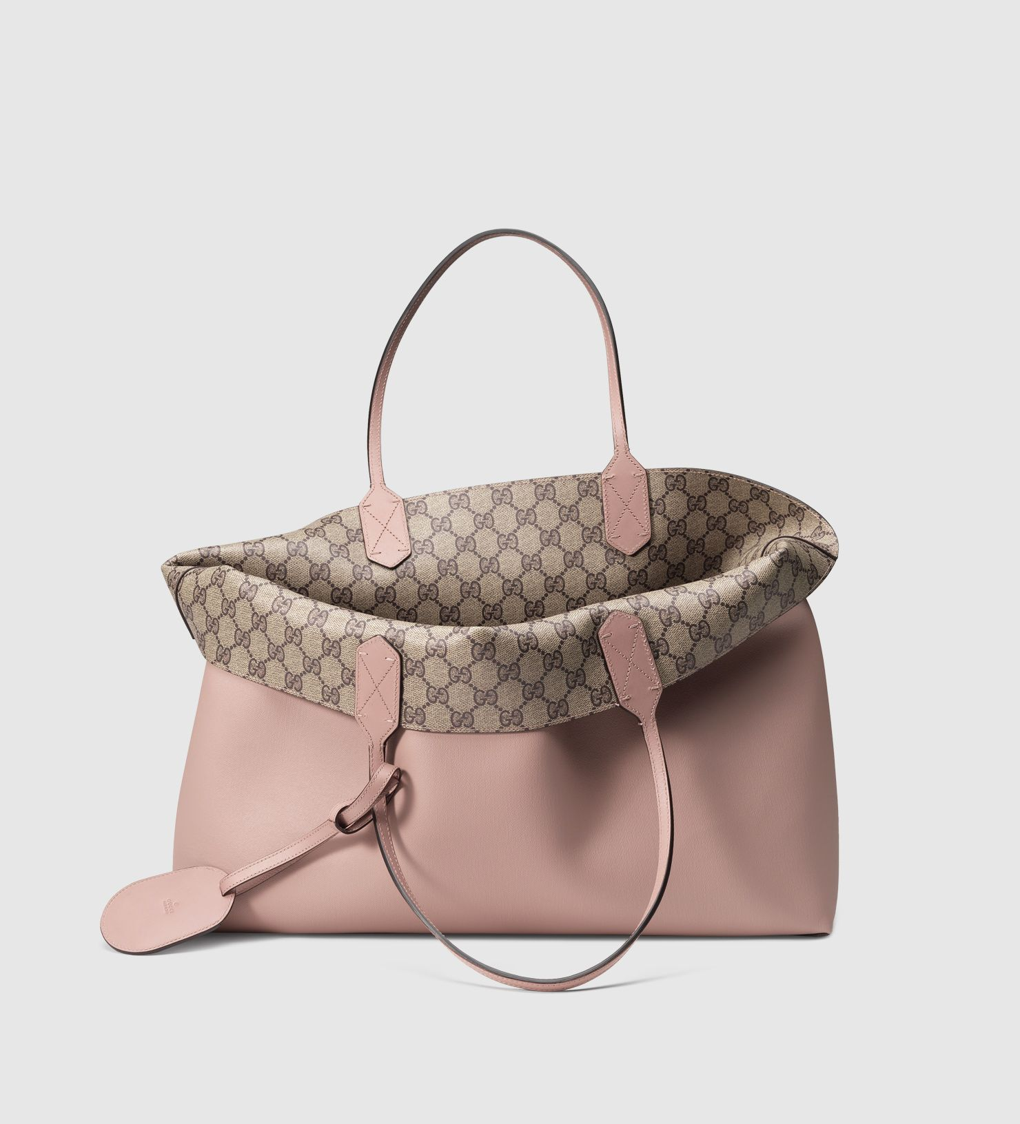 8c10f33af4f6 Gucci Reversible Tote - Designer Authentication Services for Handbags
