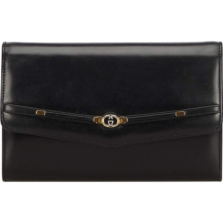 c5a342eec721 ShopStyle Collective. ShopStyle Collective Gucci Clutch Bag, Leather ...