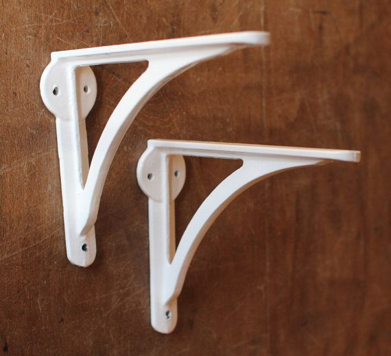 PAIR OF HEAVY DUTY CAST IRON ANTIQUE SHELF BRACKETS LARGE 7  A solid heavy Pair of Cast Iron Ironbridge Shelf Brackets designed & named after the famous Iron Bridge in Shropshire, England.  Made in our British foundry using traditional casting methods from solid Cast Iron & powder coated in a tough long lasting weatherproof white finish.  DIMENSIONS Shelf Side: 7 | Wall Side: 5 3 Holes for wall fixing and 1 for shelf fixing.  Sold complete with matching screws.
