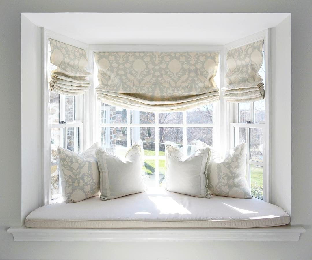 Cozy up a bay window with pretty curtains an upholstered - Living room bay window treatments ...