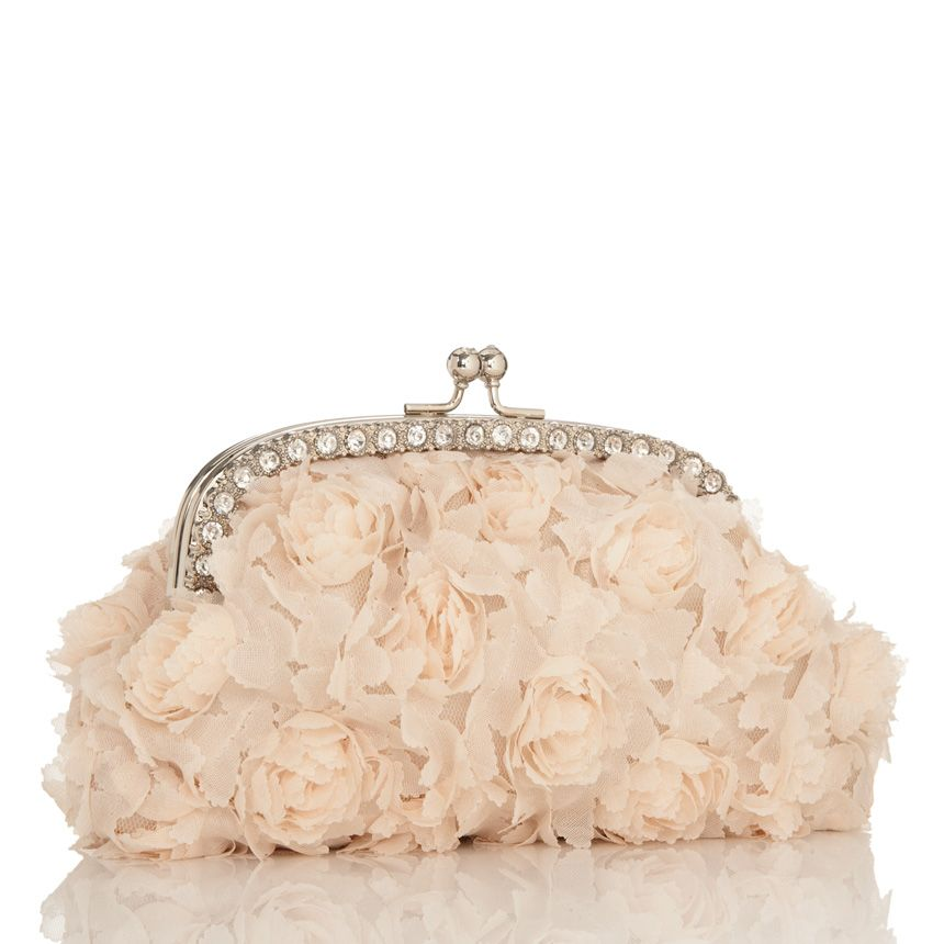 Such a pretty clutch covered in ruffles and rosettes $39.95