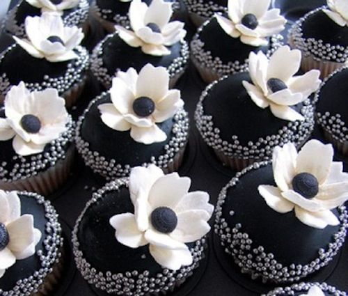 Ooh-la-la!   These couture creations may make you swoon: jet black baby cakes topped with silver dragees and sugary white anemones.