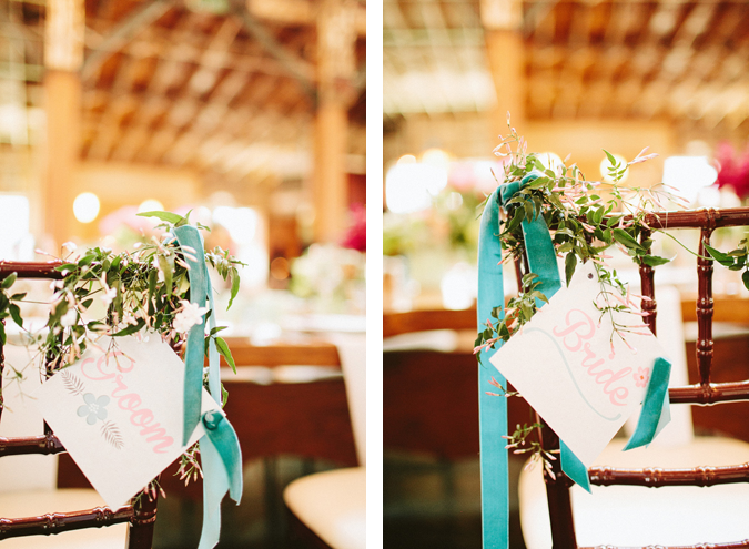 A touch of blue from the velvet ribbon used to hang them from chairs from Melanie Benson Floral Design