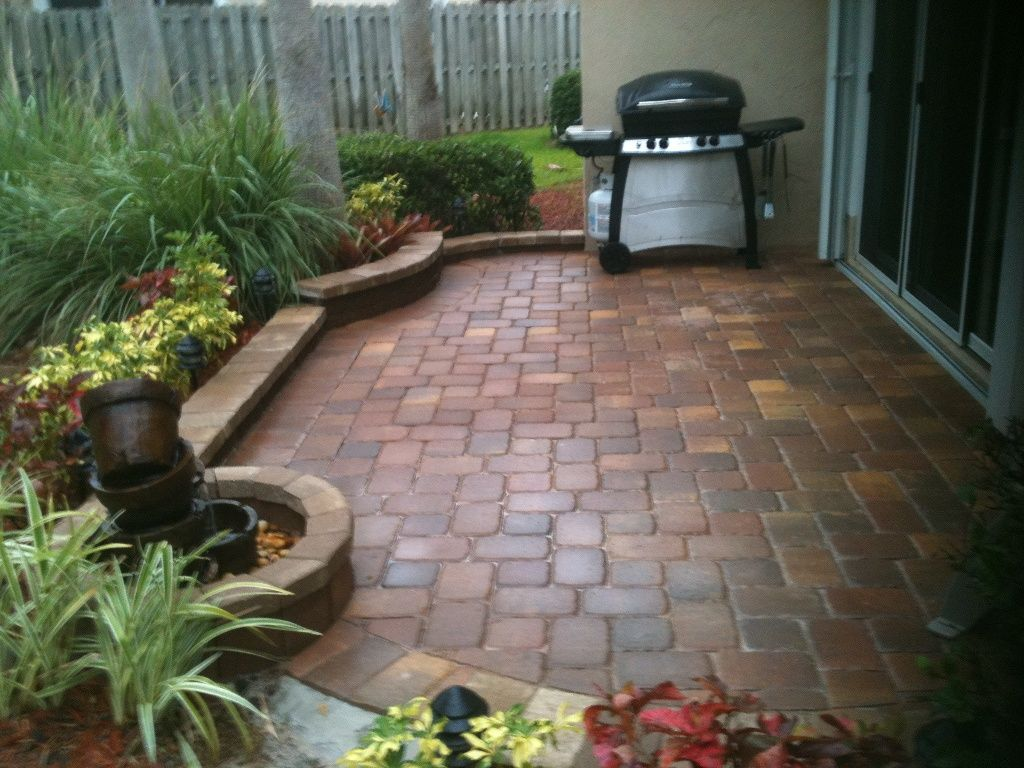 paver patio in a small space brick bordered planting