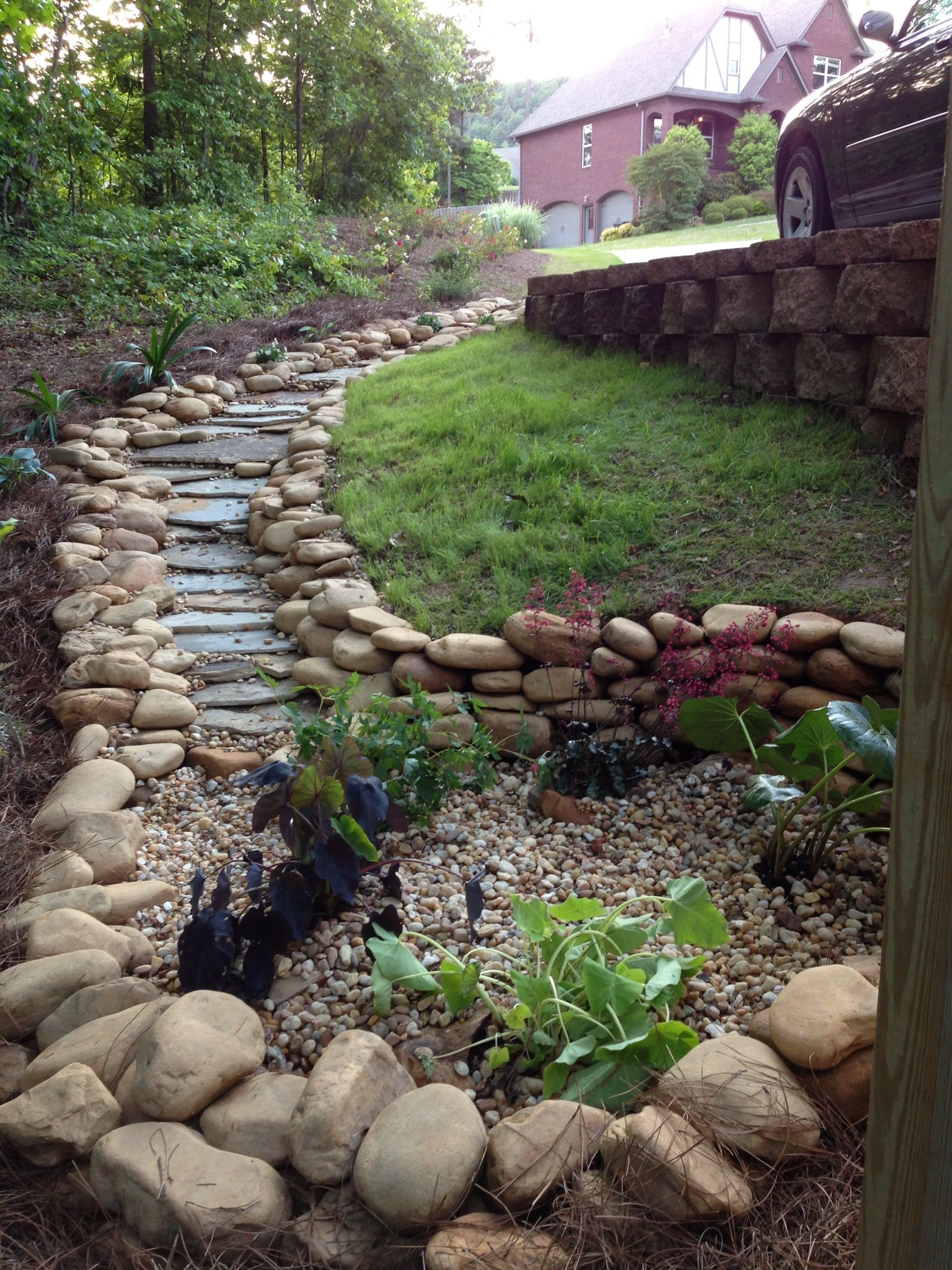 The dry creek bed that ends into a rain garden. I designed