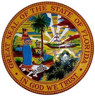 Florida State Seal Plaque: The seal features a Seminole Native American woman spreading flowers in the foreground, a sabal palm, which is the Florida State Tree, along a shoreline. In the background there is a steamboat set against the sun on the horizon with rays of sunlight extending into the sky.