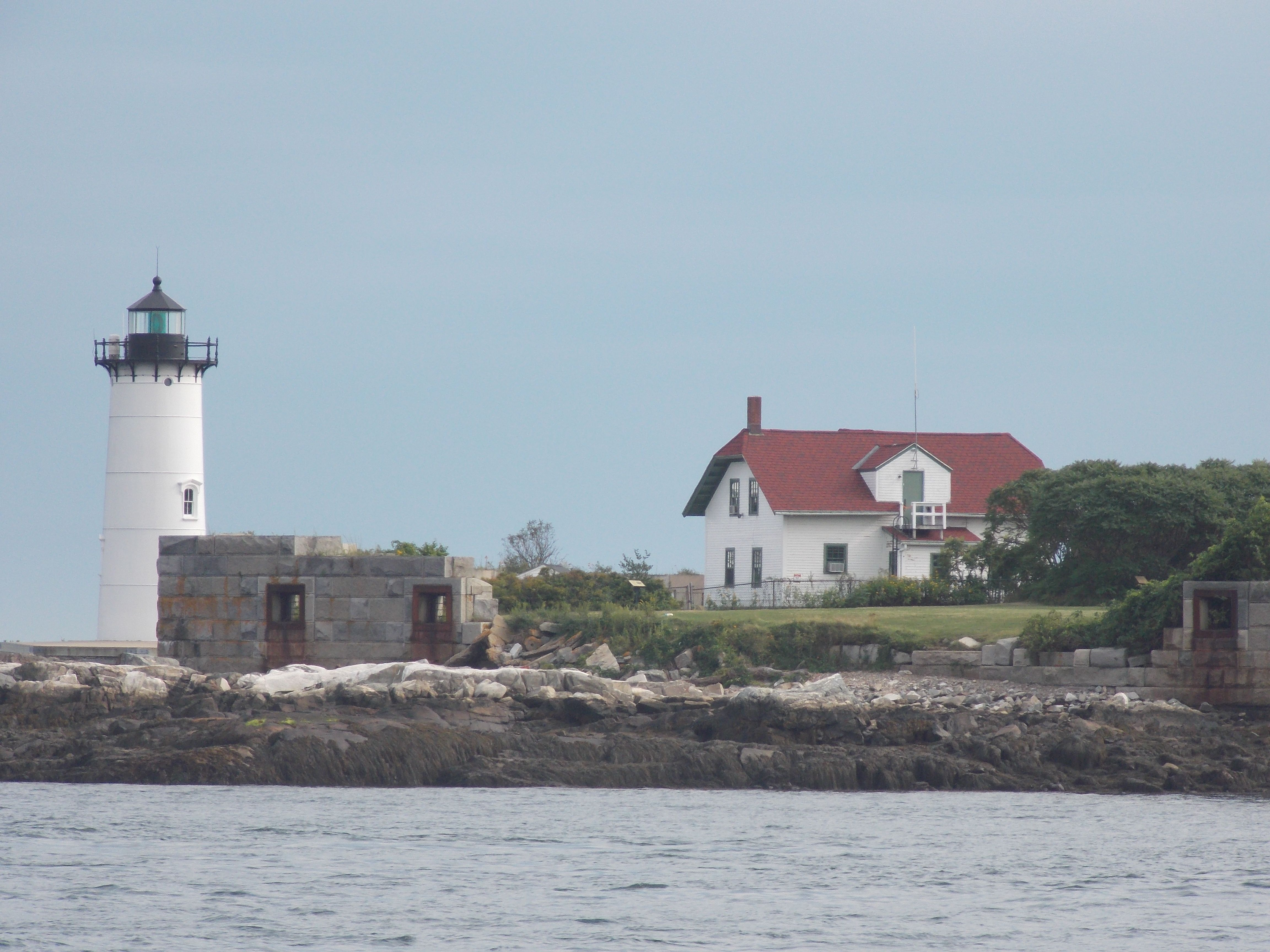 In 1771, Royal Governor John Wentworth had a lighthouse built here on Fort Point. Constructed of wood and hexagonal in shape, the Portsmouth Light was the tenth to be built in North America. One of the duties of the lighthouse keeper was to keep the wicks of the oil lanterns trimmed so the light wouldn't die out.