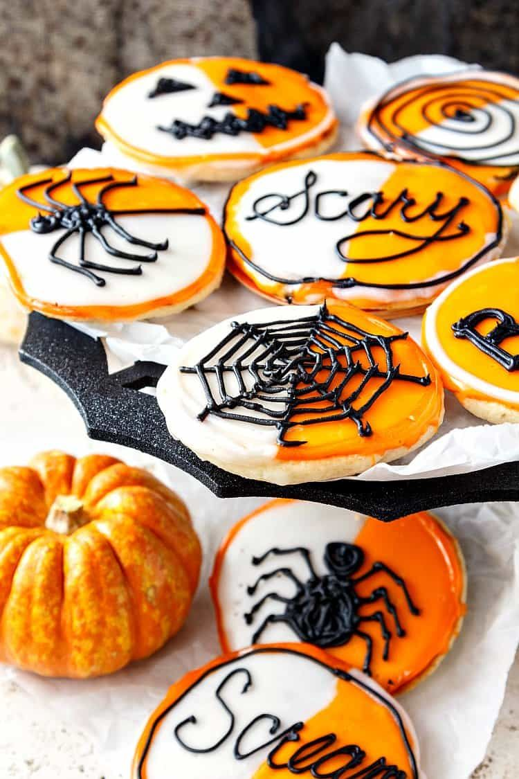 Make black and white cookies for Halloween by decorating ...