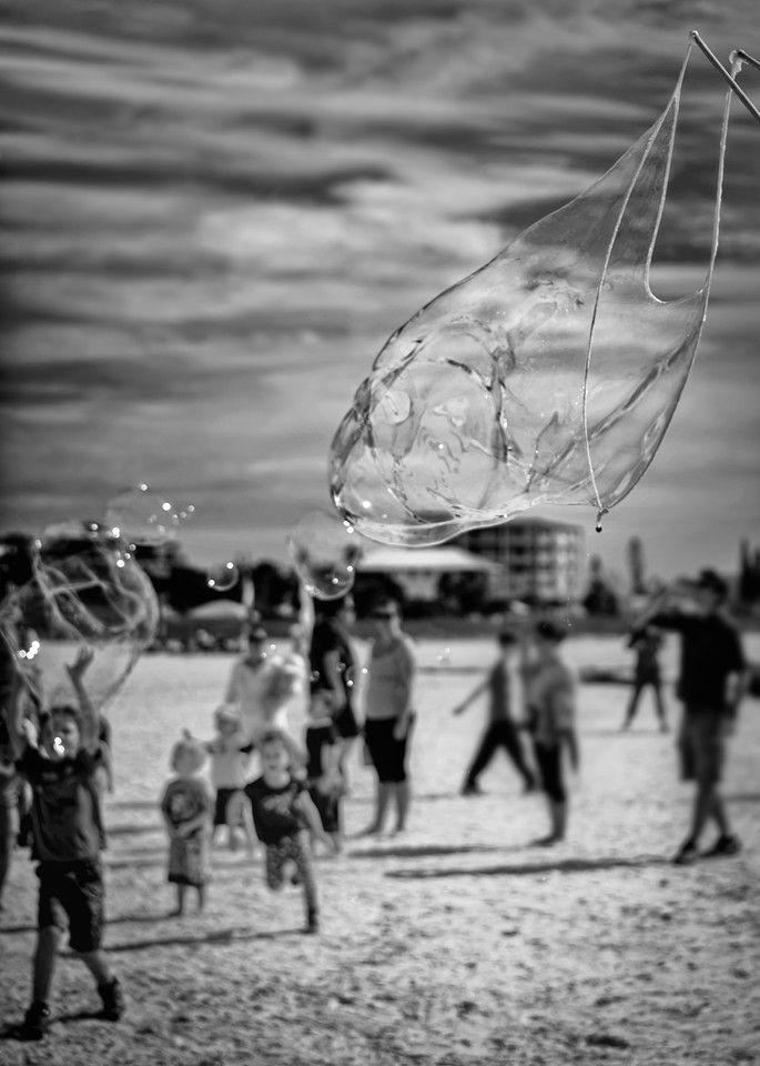 Couple of weekends ago I was at the beach and this lady was creating huge bubbles with soap, string and the ocean breeze. She was like the pied piper with all the kids chasing and popping the bubbles as they floated over their heads. Does that sound like fun or what?