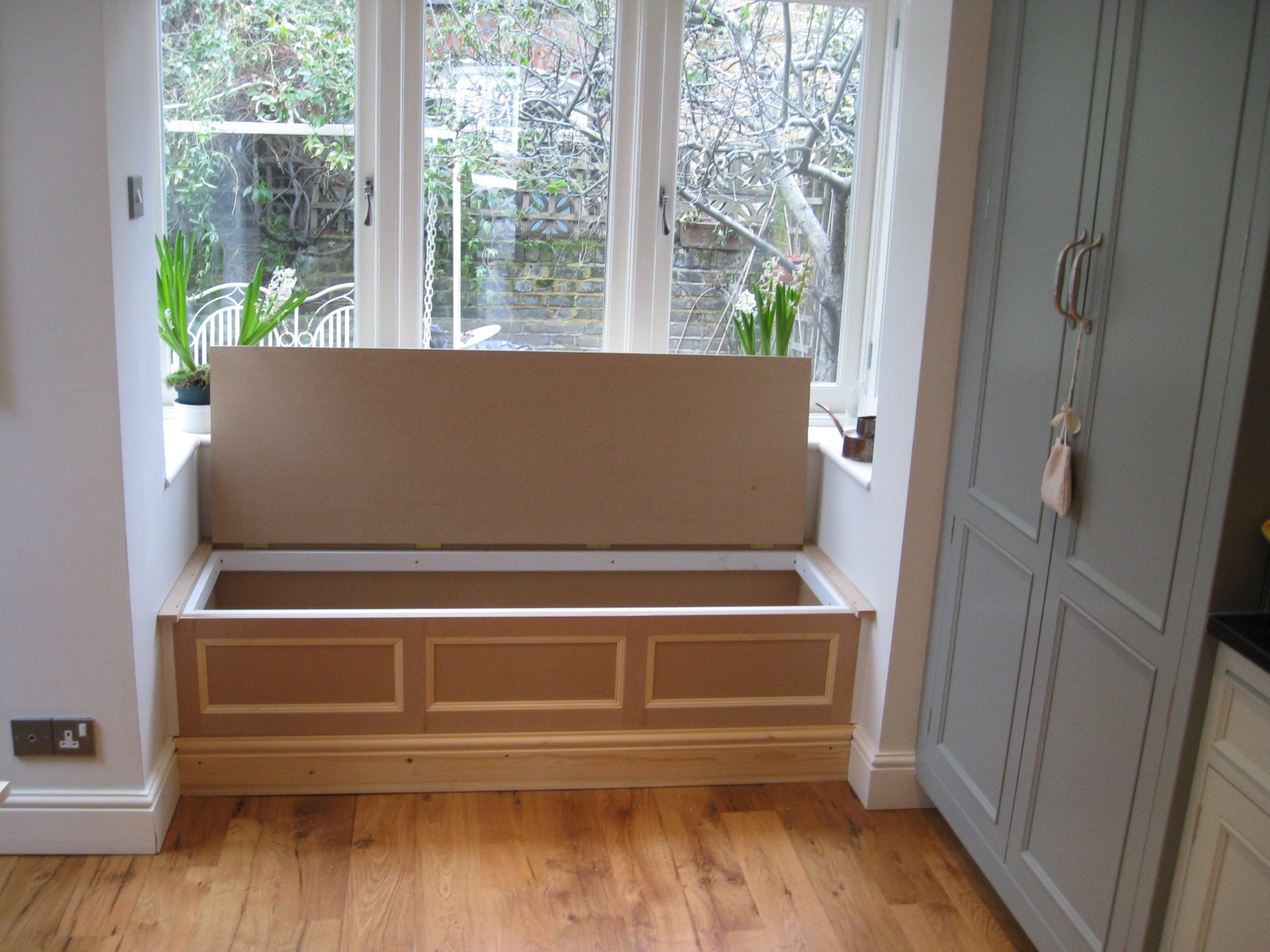 A bay window, which could include a window seat provides light