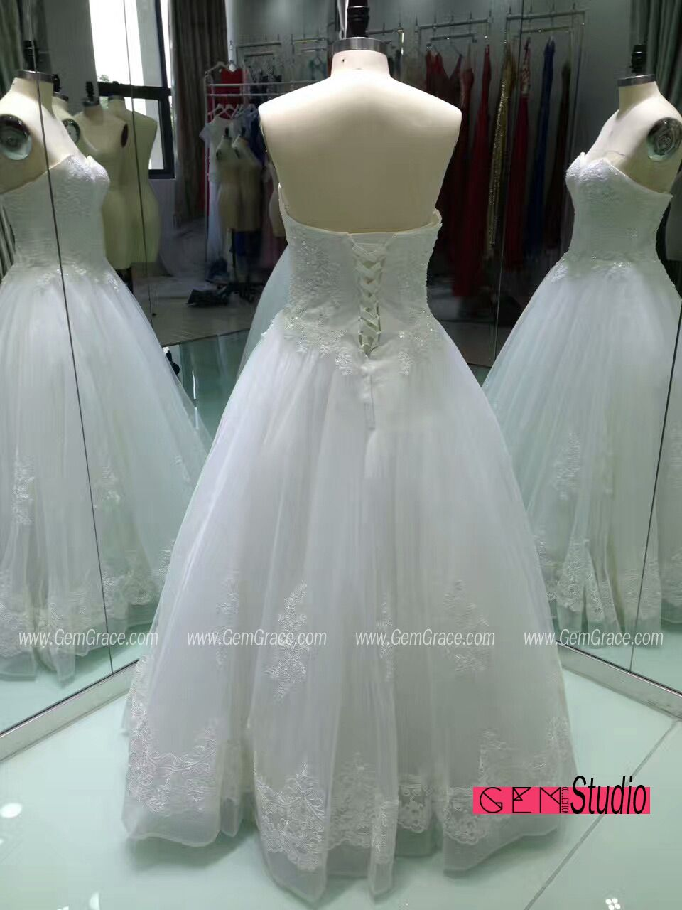Custom lace ballgown wedding dress with corset back Custom with
