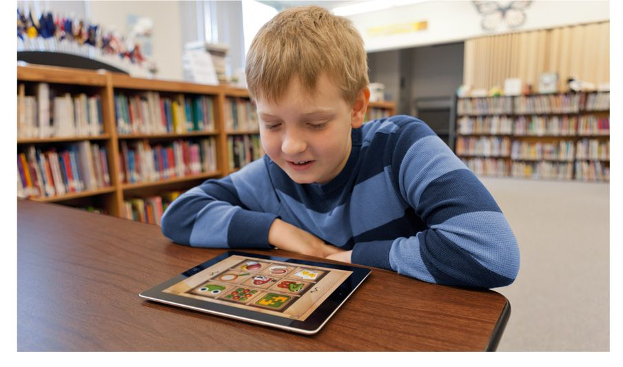 Apple accessibility student in classroom using an