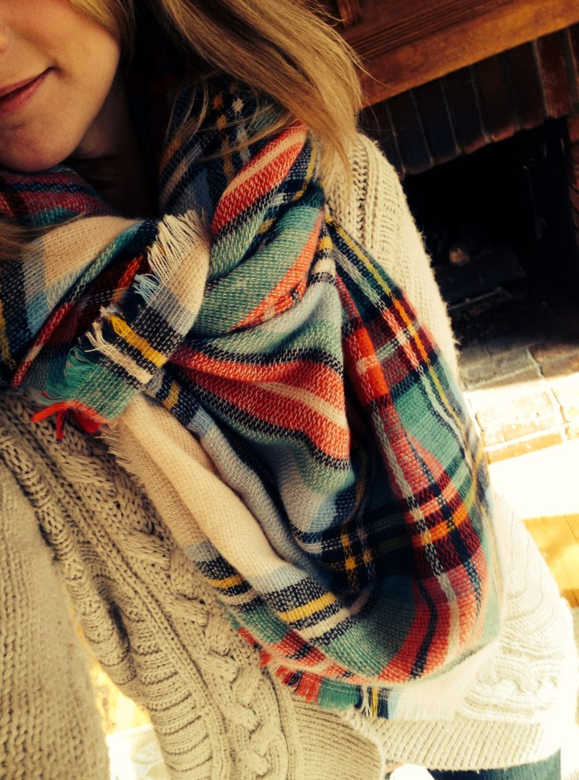 A Plaid Blanket Scarf With A Cozy Cable Knit Sweater Is