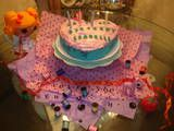 Bella's cake last year.  Will use similar decorations around her cake this year.