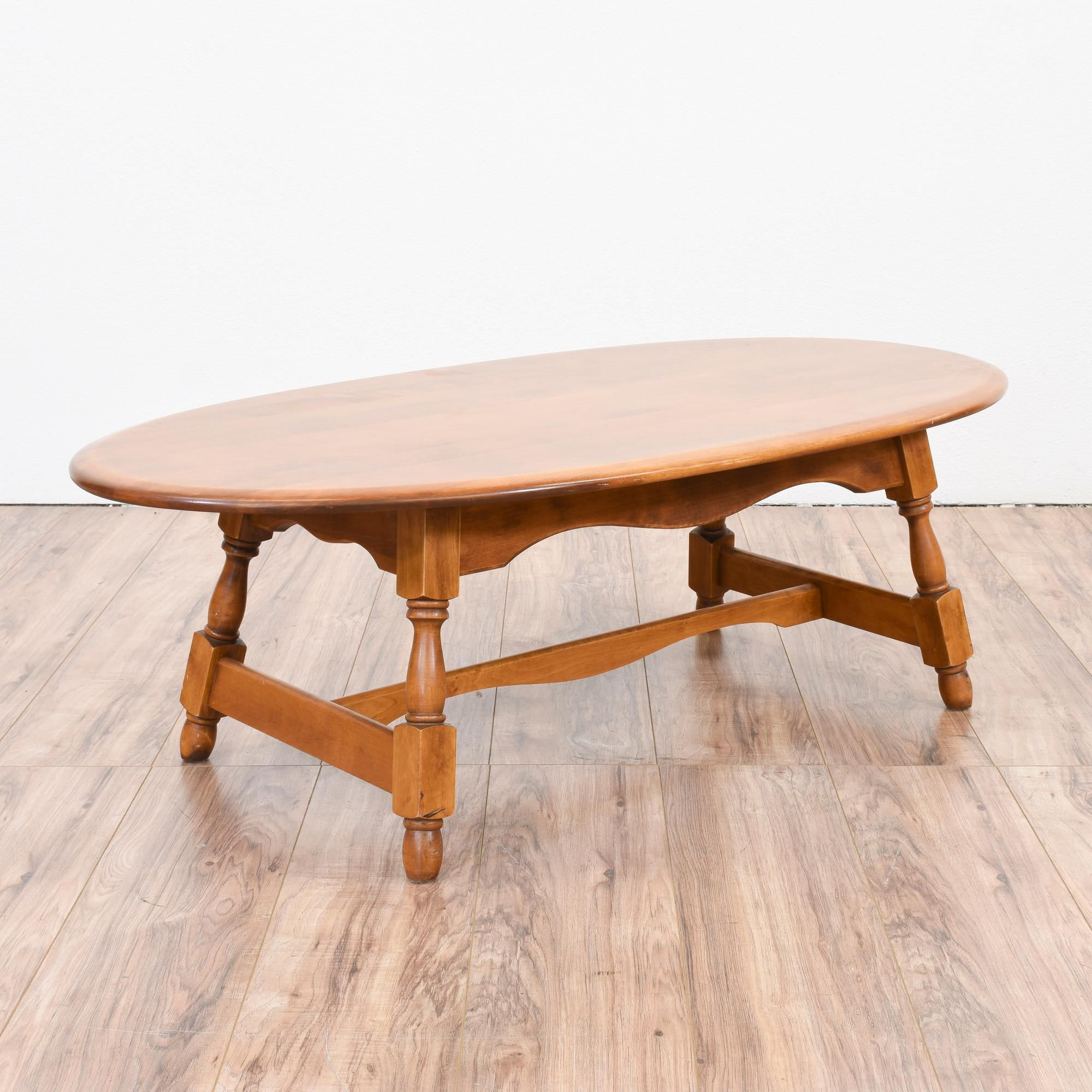 This colonial style coffee table is featured in a solid wood with