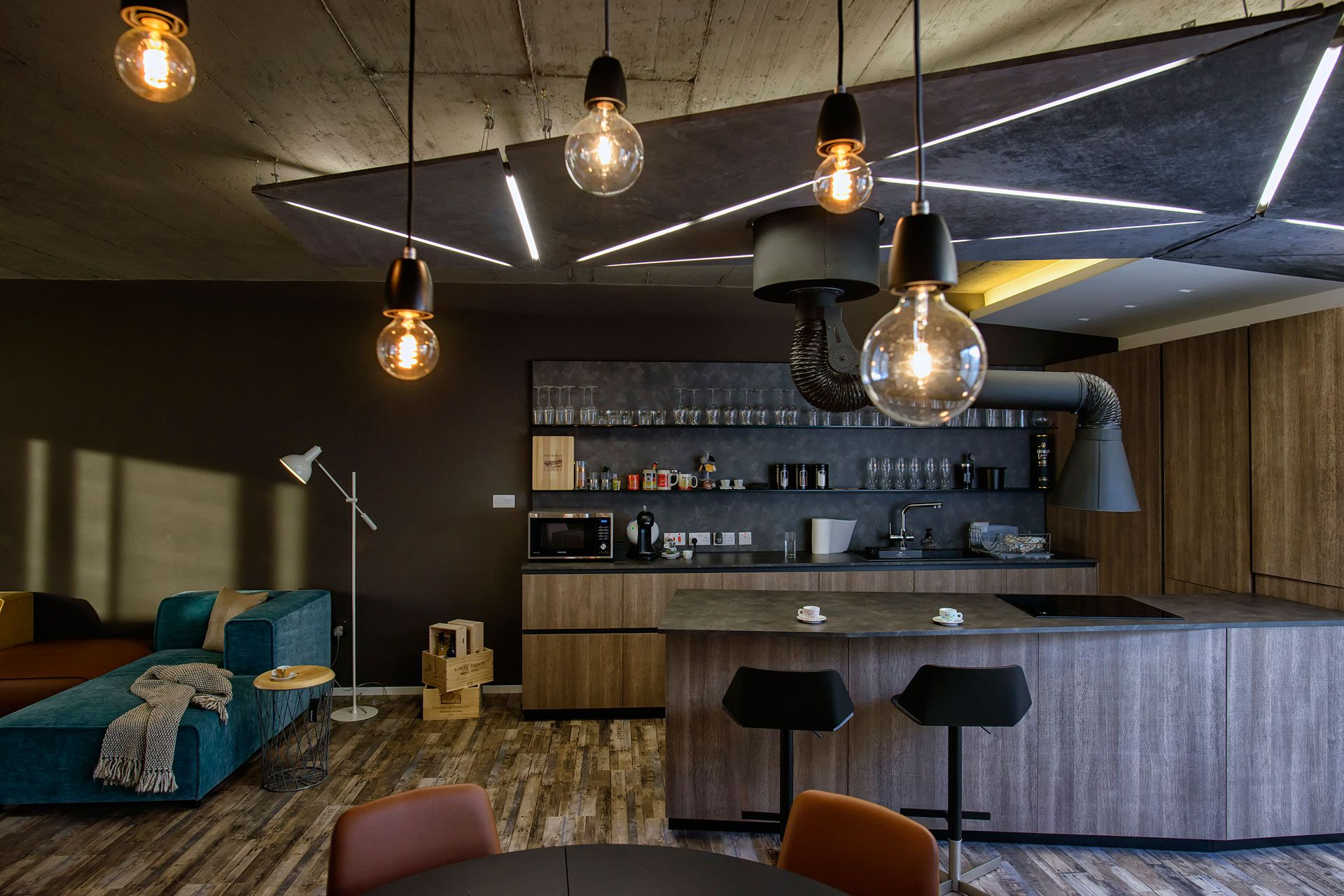 Kitchen by Aster Cucine at Brands International Bar stools, dining chairs and table, pendant lights by BoConcept at Brands International Photography - Peter M. Mercieca
